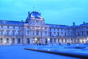 outside the louvre museum at dusk